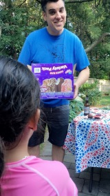 My husb giving his niece the box of ice cream
