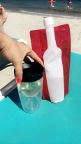 the best beach accessories around... wine bottle and glass! haha
