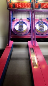 Uhm, so i love two games more than anything... skee ball and air hockey.. i will play anyone and CRUSH THEM. haha seriously, I will beat you and Monica Gellar dance in yo face!