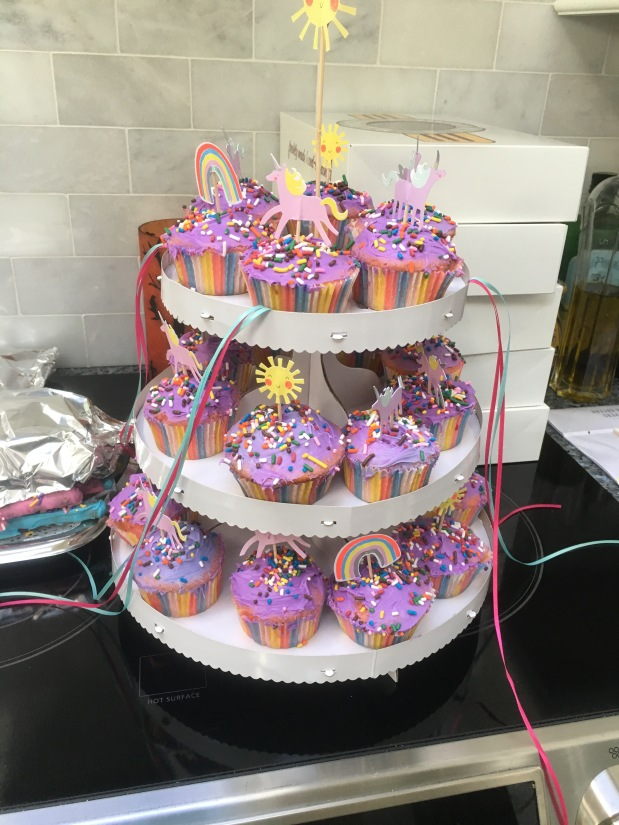 Unicorn cupcakes (strawberry cake with purple frosting)