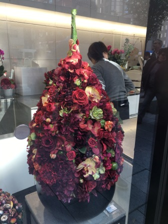 A florist on the street making flower trees.. the color was magnificent