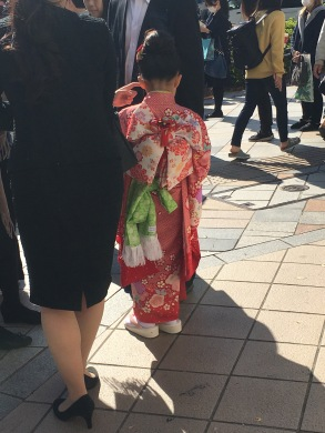 I saw this little girl on the street, so beautiful. I wasn't aware of the Shrine nearby or that they dress up on bdays.