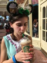 Starbucks Minnie Ears with her frappuccino