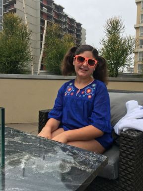 Our youngest at the rooftop pool