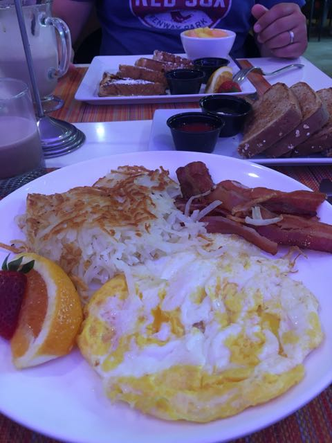 Two eggs w bacon and toast - and french toast in background- Breakfast at Indigo Hotel