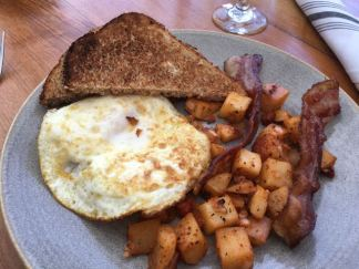 Hawaiian Breakfast :) I am the eggs, toast and bacon girl. Potatoes make it even better!