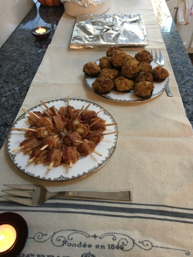Appetizers, scallops wrapped in bacon and sausage stuffing stuffed mushrooms.
