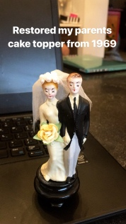 My parents original cake topper that I restored the best I could for them. Replaced some veil, added the flower and the pearl headband.