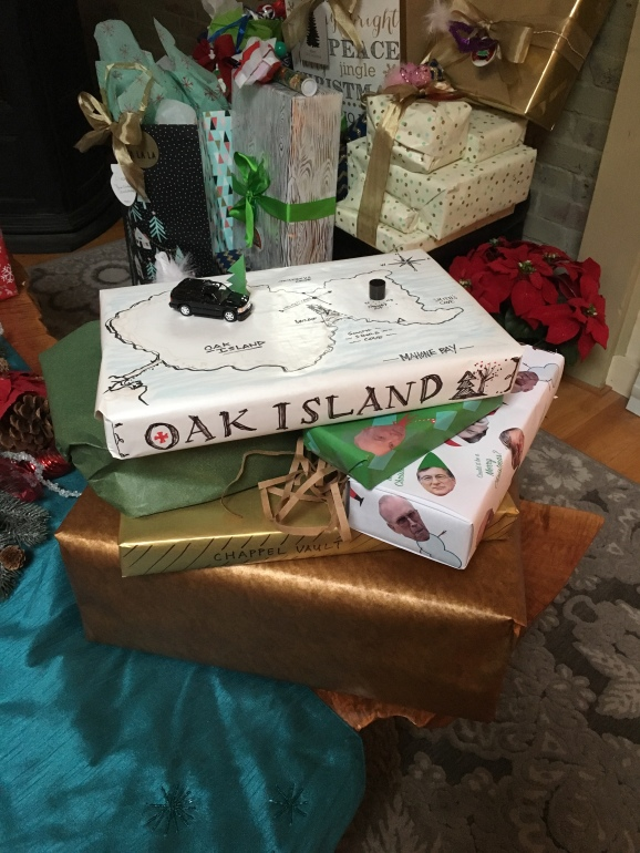 My husband is the best husband in the world. He takes surprising me to the next level of awesome. Here is this year's theme... Curse of Oak Island THeme Wrapping
