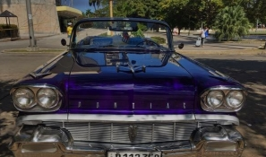Super cool purple vintage Pontiac convertible