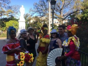 Fun group- They are dressed Carmen Miranda-styled in traditional colonial costume.