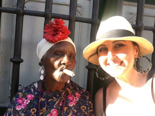 Havana - Cuban woman smoking cigar, waiting to take photos :)