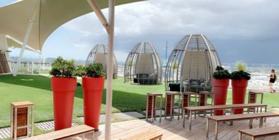 The upstairs grass with cabanas..